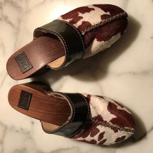 Dolce and Gabbana cow skin clogs.